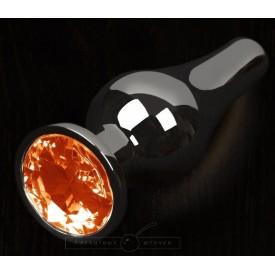 Графитовая удлиненная анальная пробка с оранжевым кристаллом - 8,5 см.